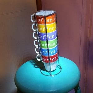 Six coffee mugs in a stackable holder